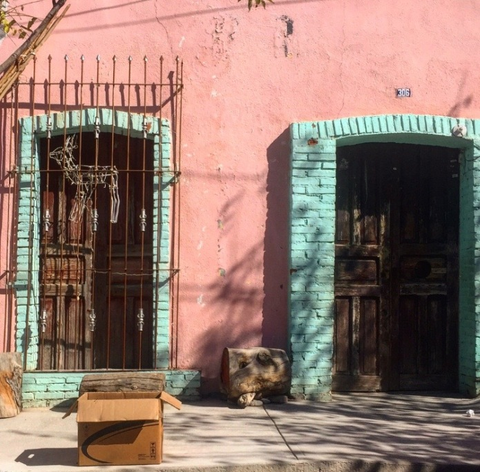 Pink and turquoise door